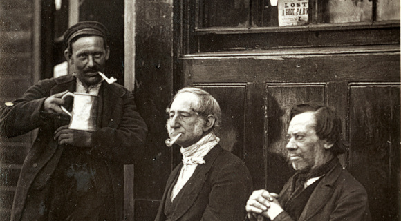 Men outside a shop drinking and smoking